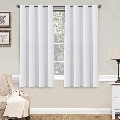 white curtains window treatment room